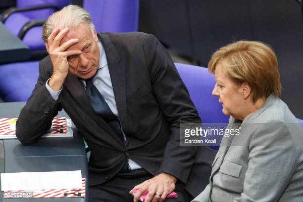 German Chancellor Angela Merkel and Juergen Trittin of German Greens Party chat during the opening session of the new Bundestag on October 24 2017 in...