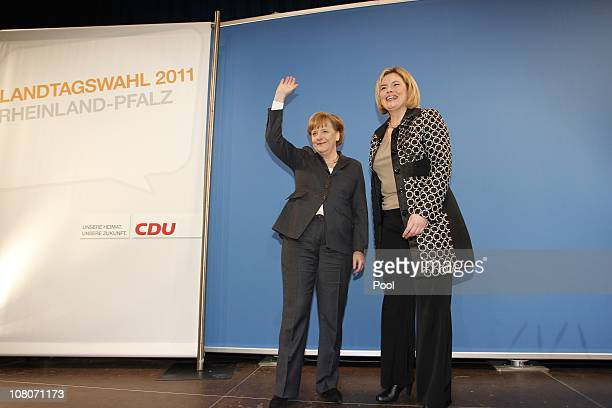 German Chancellor Angela Merkel and Julia Kloeckner top candidate of CDU greet party members during the New Year's reception of her conservative...