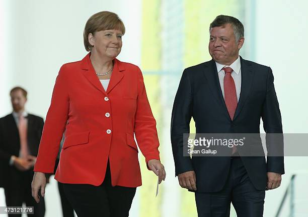 German Chancellor Angela Merkel and King Abdullah II of Jordan arrive to speak to the media following talks at the Chancellery on May 13, 2015 in...