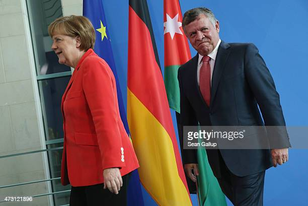 German Chancellor Angela Merkel and King Abdullah II of Jordan depart after speaking to the media following talks at the Chancellery on May 13, 2015...