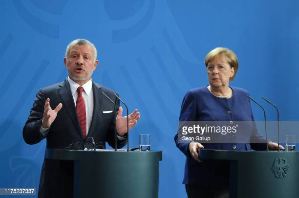 German Chancellor Angela Merkel and King Abdullah II of Jordan speak to the media following talks between the two leaders at the Chancellery on...
