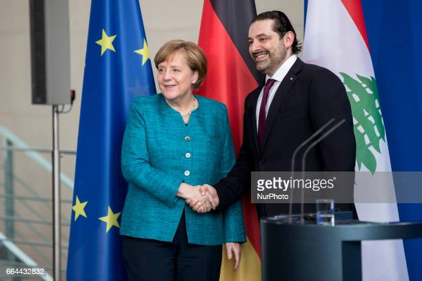 German Chancellor Angela Merkel and Lebanese Prime Minister Saad Hariri shake hands after addressing the media before a lunch meeting in Berlin...