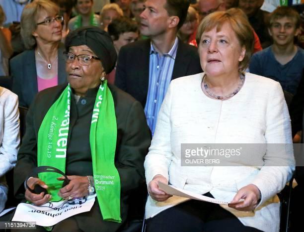 German Chancellor Angela Merkel and Liberia's former president Nobel Peace Prize laureate Ellen Johnson Sirleaf attend the German Protestant Church...