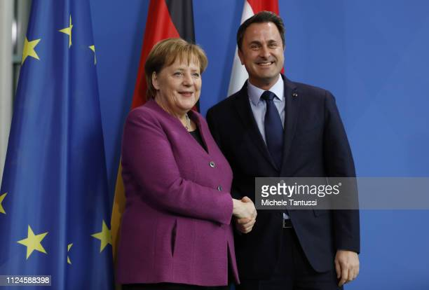 German Chancellor Angela Merkel and Luxembourg Prime Minister Xavier Bettel shake hands after they spoken to the media at the Chancellery on February...