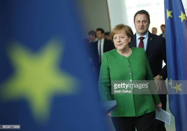 German Chancellor Angela Merkel and Luxembourg Prime Minister Xavier Bettel arrive to give statements to the media following talks at the Chancellery...