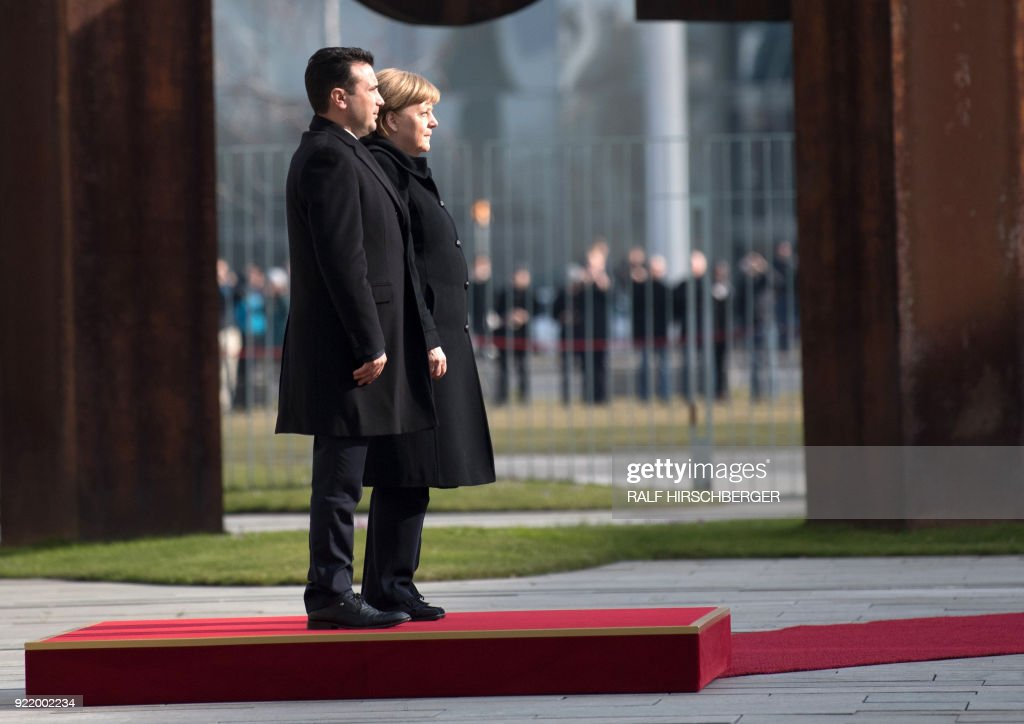 German Chancellor Angela Merkel and Macedonian Prime Minister Zoran Zaev take part in a welcoming ceremony before a meeting on February 21, 2018 in Berlin. / AFP PHOTO / dpa / Ralf Hirschberger / Germany OUT
