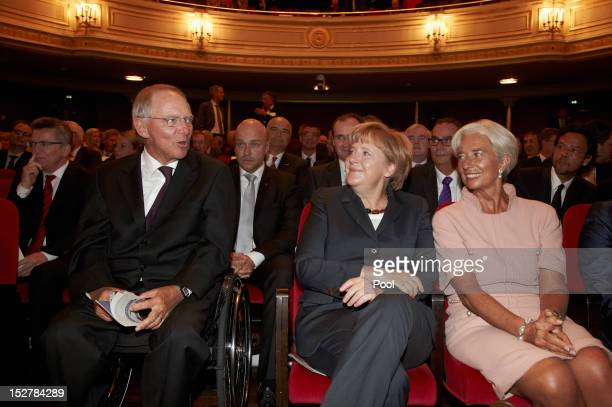 German Chancellor Angela Merkel and Managing Director of the International Monetary Fund Christine Lagarde look to German Finance Minister Wolfgang...