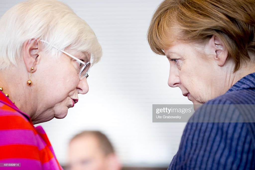 German Chancellor Angela Merkel and member of parliament Gerda Hasselfeldt (CSU, R) attend a working session of CDU-faction in German Bundestag on July 01, 2014 in Berlin, Germany.