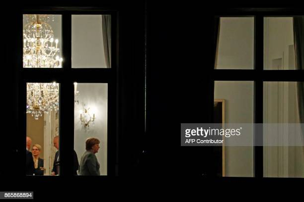 German Chancellor Angela Merkel and members of the delegations of the CDU/CSU conservative alliance the liberal FDP party and the leftleaning Green...