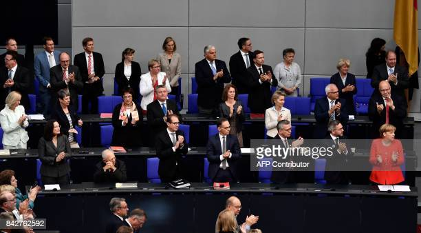 German Chancellor Angela Merkel and members of the parliament applaud Norbert Lammert president of the Bundestag after he gave a speech to open a...