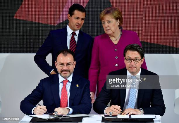 German Chancellor Angela Merkel and Mexican President Enrique Pena Nieto look on as German Transport Minister Andreas Scheuer and Mexican Minister of...