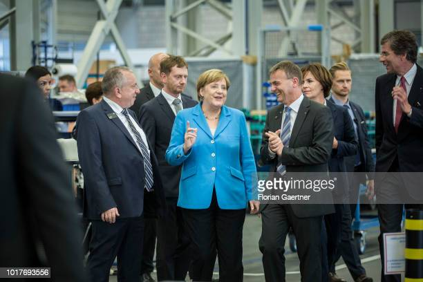 German Chancellor Angela Merkel and Michael Kretschmer prime minister of the German State of Saxony are pictured with Harry Thonig managing director...