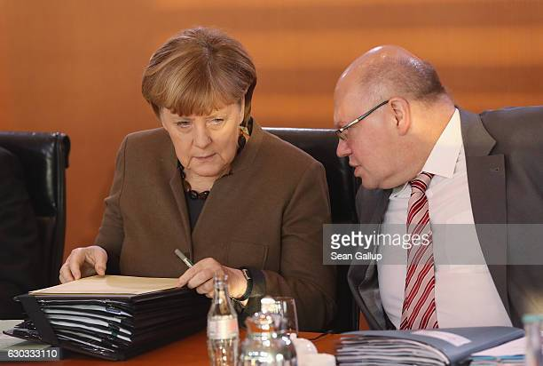 German Chancellor Angela Merkel and Minister of the Chancellery Peter Altmeier arrive for the weekly government cabinet meeting on December 21 2016...