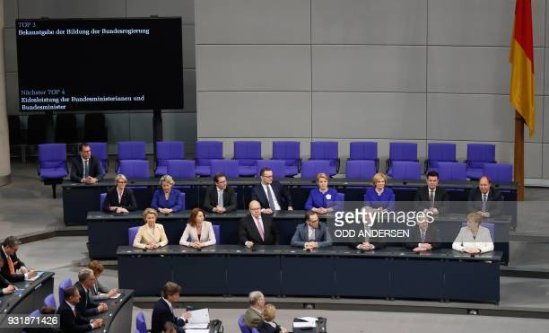 German Chancellor Angela Merkel and ministers of her new cabinet have taken seat on the government's bench during a session at the Bundestag on March...