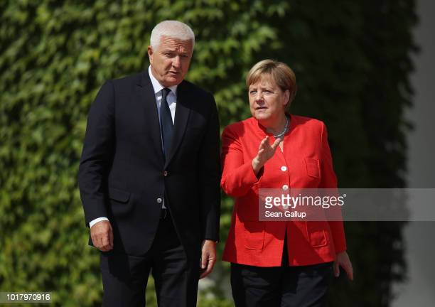 Montenegro Prime Minister Dusko Markovic and German Chancellor Angela Merkel speak to the media following talks at the Chancellery on August 17 2018...