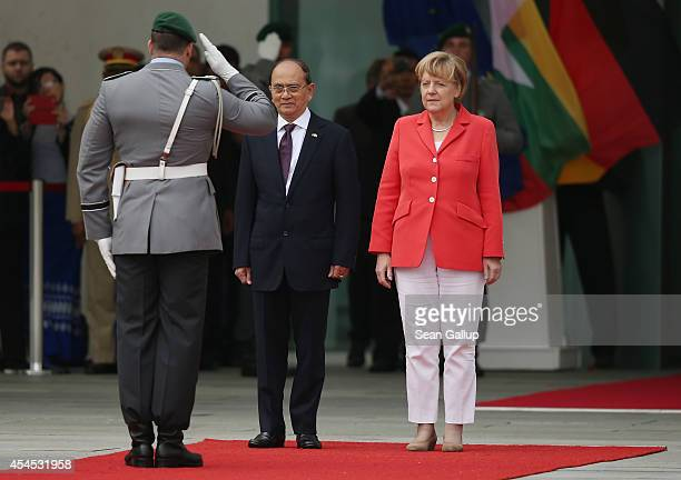 German Chancellor Angela Merkel and Myanmar President Thein Sein review a guard of honour upon Thein Sein's arrival at the Chancellery on September...