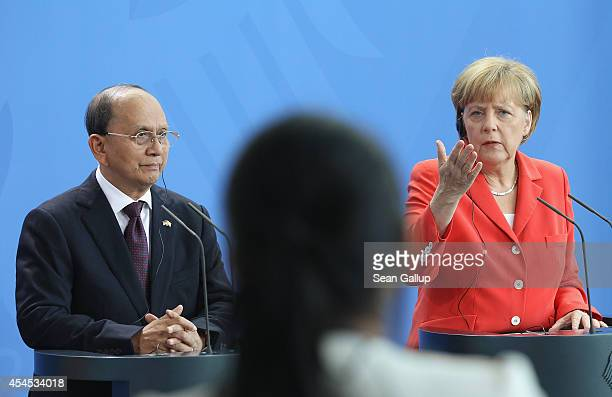 German Chancellor Angela Merkel and Myanmar President Thein Sein answer a reporter's quesiton following bilateral talks at the Chancellery on...