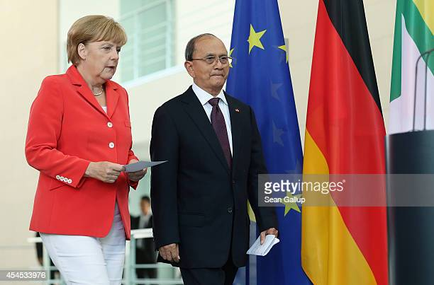 German Chancellor Angela Merkel and Myanmar President Thein Sein arrive to speak to the media following bilateral talks at the Chancellery on...