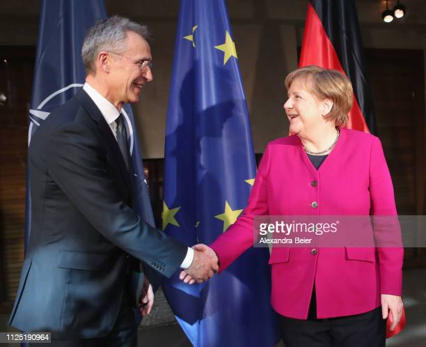 German Chancellor Angela Merkel and NATO general secretary Jens Stoltenberg shake hands during a photo call before bilateral talks during the 55th...