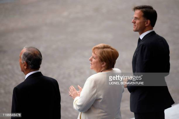 German chancellor Angela Merkel and Netherlands' Prime minister Mark Rutte attend the Bastille Day military parade down the ChampsElysees avenue in...
