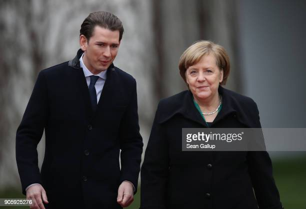 German Chancellor Angela Merkel and new Austrian Chancellor Sebastian Kurz prepare to review a guard of honour upon Kurz's arrival at the Chancellery...