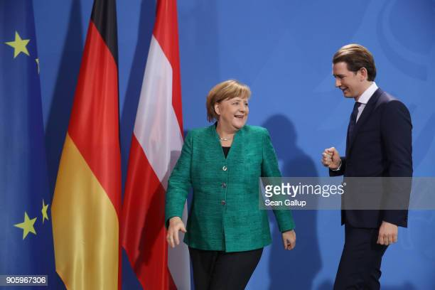 German Chancellor Angela Merkel and new Austrian Chancellor Sebastian Kurz depart after speaking to the media following talks at the Chancellery on...