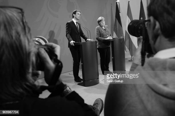 German Chancellor Angela Merkel and new Austrian Chancellor Sebastian Kurz speak to the media following talks at the Chancellery on January 17 2017...