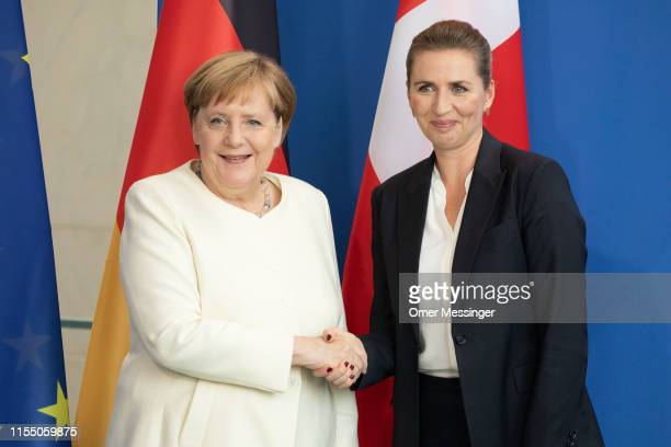 German Chancellor Angela Merkel and new Danish Prime Minister Mette Frederiksen shake hands after a joint press conference at the Chancellery on July...