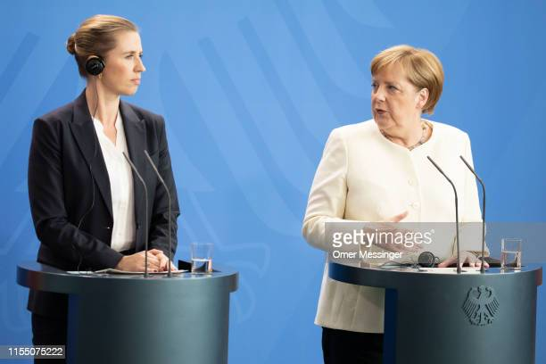 German Chancellor Angela Merkel and new Danish Prime Minister Mette Frederiksen attend a joint press conference at the Chancellery on July 11, 2019...