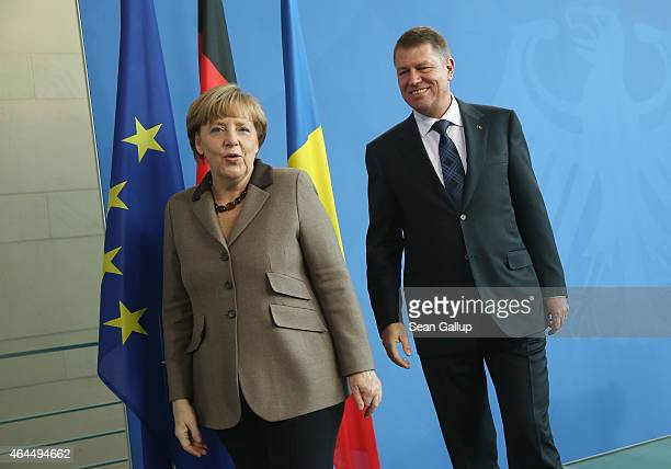 German Chancellor Angela Merkel and new Romanian President Klaus Iohannis depart after speaking to the media following bilateral talks at the...