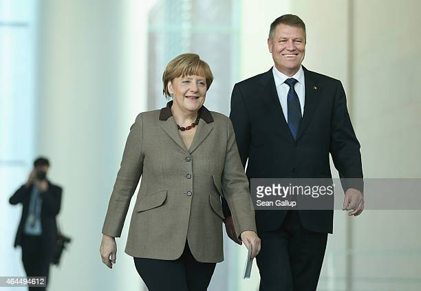 German Chancellor Angela Merkel and new Romanian President Klaus Iohannis arrive to speak to the media following bilateral talks at the Chancellery...