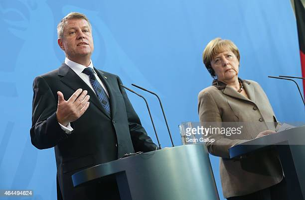 German Chancellor Angela Merkel and new Romanian President Klaus Iohannis speak to the media following bilateral talks at the Chancellery on February...