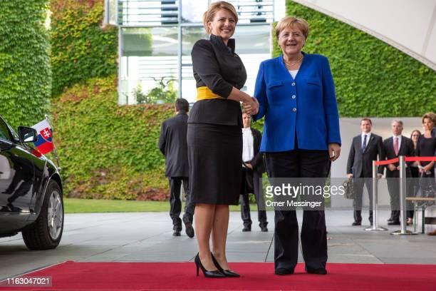 German Chancellor Angela Merkel and new Slovak President Zuzana Caputova shake hands upon Caputova's arrival at the Federal Chancellery on August 21...