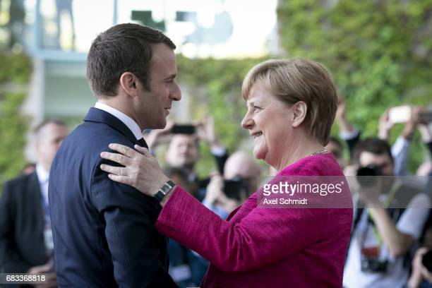 German Chancellor Angela Merkel and newlyelected French President Emmanuel Macron chat upon Macron's arrival at the Chancellery on May 15 2017 in...
