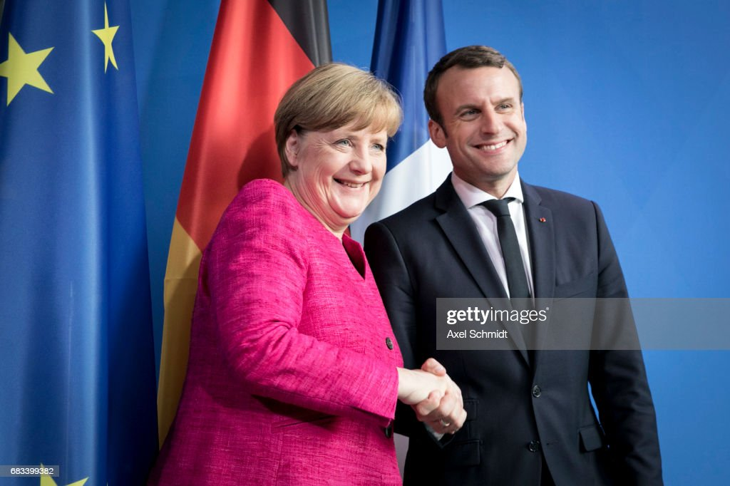 German Chancellor Angela Merkel and newly-elected French President Emmanuel Macron attend a press conference at the Chancellery on May 15, 2017 in Berlin, Germany. Macron is visiting Berlin only a day after being sworn in as president in Paris. While Macron and Merkel have both demonstrated an unwavering commitment to the European Union and Merkel strongly applauded Macron's election, they are likely to differ over Macron's desire for E.U.-issued bonds, a measure Merkel has strongly opposed in the past.