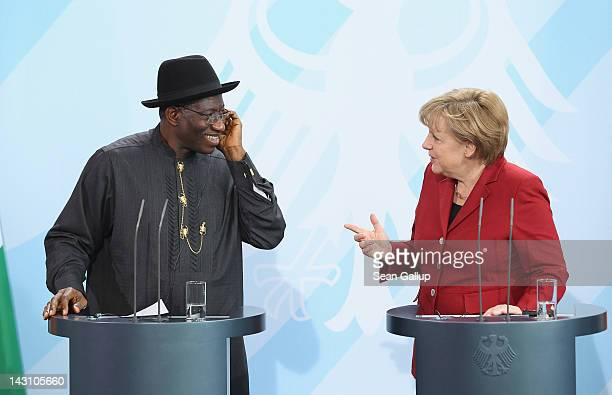 German Chancellor Angela Merkel and Nigerian President Goodluck Jonathan speak to the media after talks at the Chancellery on April 19 2012 in Berlin...