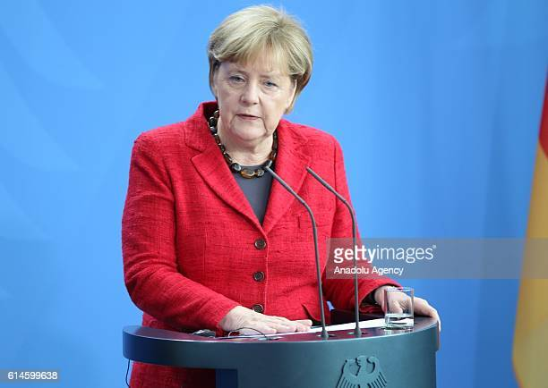 German Chancellor Angela Merkel and Nigerian President Muhammadu Buhari hold a joint press conference after their meeting in Berlin Germany on...