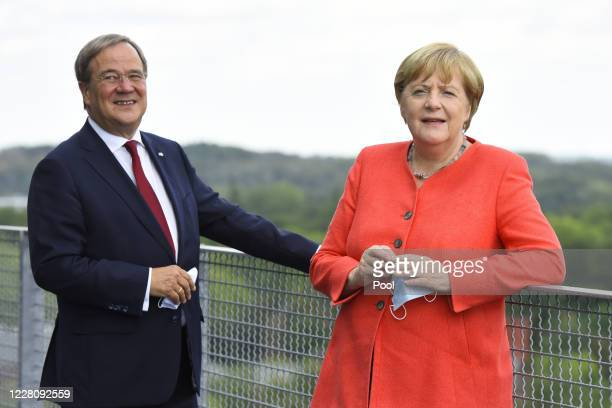 German Chancellor Angela Merkel and North Rhine-Westphalia Governor Armin Laschet visit the Ruhr Conference at the Zeche Zollverein former coal mine...