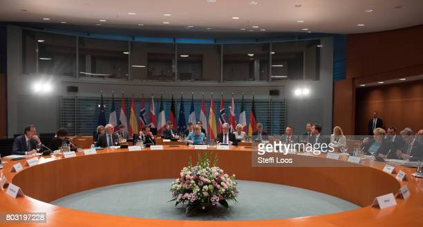 German Chancellor Angela Merkel and other EU Leaders attend a meeting of EU Leaders before G20 Summit on June 29 2017 in Berlin Germany