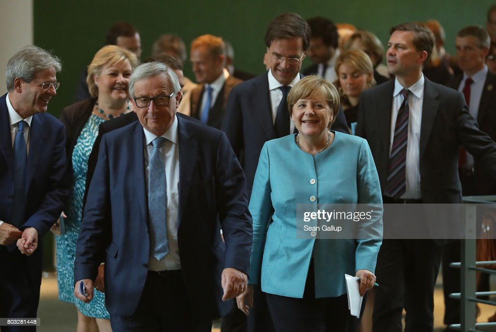 German Chancellor Angela Merkel (C-R) and other European Union leaders, including Italian Prime Minister Paolo Gentiloni (L), Norwegian Prime Minister Erna Solberg (2nd from L), European Commission President Jean-Claude Juncker (C-L), and Dutch Prime Minister Mark Rutte (C), arrive to speak to the media following a meeting of European Union leaders at the Chancellery on June 29, 2017 in Berlin, Germany. The leaders are meeting head of the upcoming G20 summit in Hamburg.