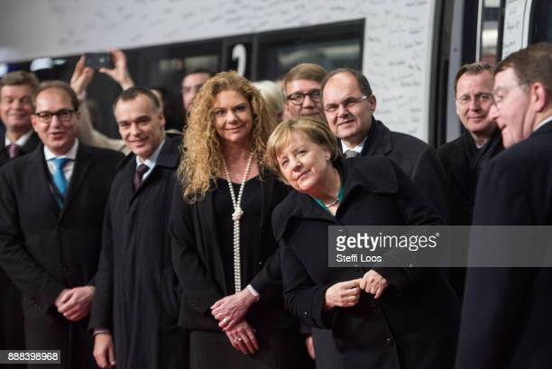 German Chancellor Angela Merkel and other guests stand in front of an ICE high speed train at the main railway station in Berlin during an...