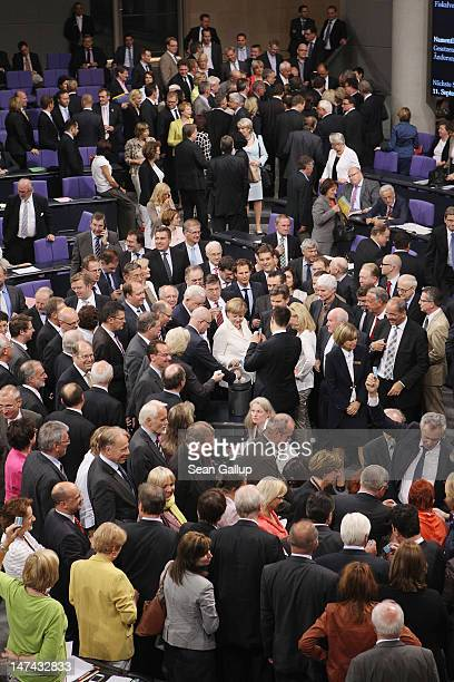 German Chancellor Angela Merkel and other MPs cast their ballots to ratify a change to Article 136 of the Contract of the European Council that would...