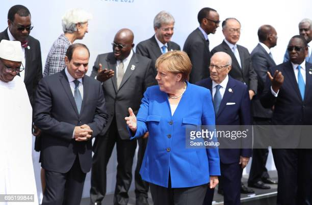 German Chancellor Angela Merkel and other participants of the G20 Africa Conference, including Egyptian President Abd El-Fattah El-Sisi and Tunisian...