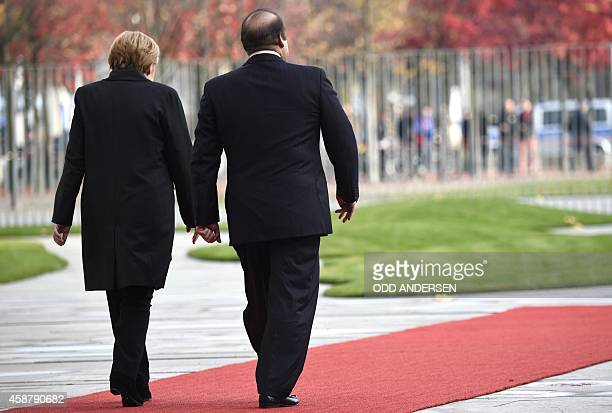 German Chancellor Angela Merkel and Pakistani Prime Minister Nawaz Sharif walk to review a military guard of honour at a welcoming ceremony at the...