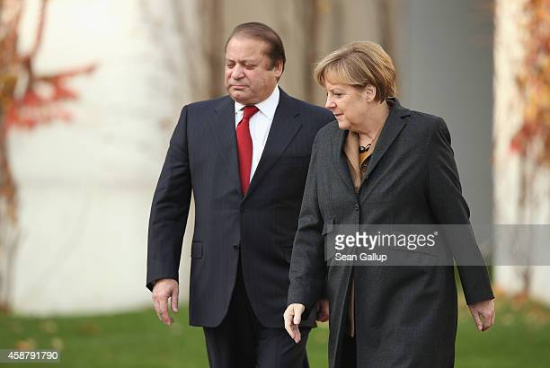 German Chancellor Angela Merkel and Pakistani Prime Minister Nawaz Sharif prepare to review a guard of honour upon Sharif's arrival at the...