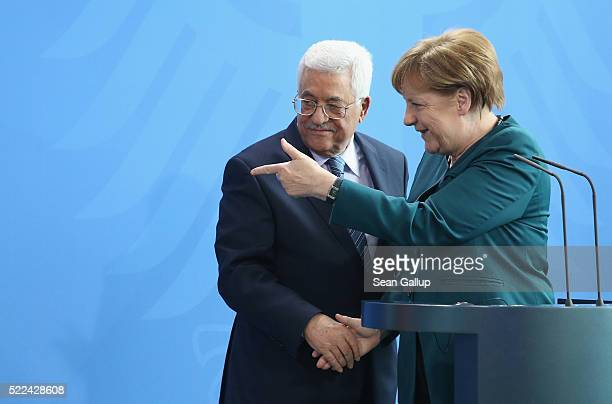 German Chancellor Angela Merkel and Palestinian President Mahmoud Abbas depart after speaking to the media following talks at the Chancellery on...
