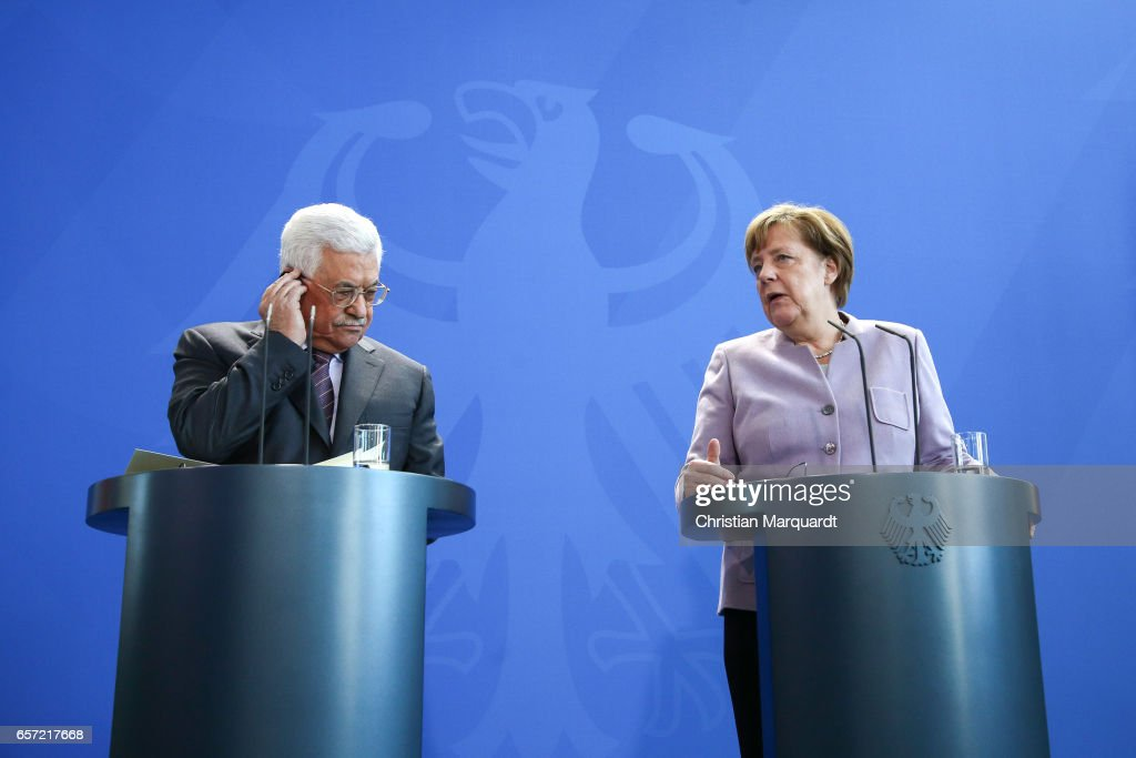 German Chancellor Angela Merkel and Palestinian President Mahmoud Abbas talk to the media ahead of a common meeting at the Chancellory on March 24, 2017 in Berlin, Germany. The current situation in the Palestinian territories, Middle East peace process and other bilateral issues are accepted to be the main topics of their meeting.