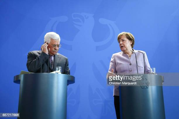 German Chancellor Angela Merkel and Palestinian President Mahmoud Abbas talk to the media ahead of a common meeting at the Chancellory on March 24...