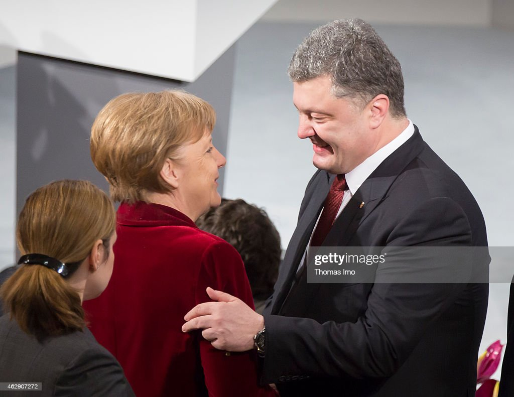 German Chancellor Angela Merkel (L) and Petro Poroshenko, president of the Ukraine greet each other after arriving at the 51st Munich Security Conference (MSC) on February 7, 2015 in Munich, Germany. Foreign ministers and defense ministers from countries across the globe are meeting to discuss current global security issues, in particular the crisis in eastern Ukraine, the spread of ISIS in Syria and Iraq and the large-scale movement and plight of refugees.