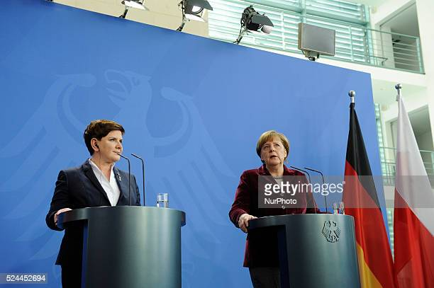 German Chancellor Angela Merkel and Poland's new Prime Minister Beata Szydlo deliver remarks during a press conference at the German Federal...